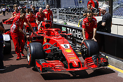 May 23, 2018 - Montecarlo, Monaco - Ferrari mechanics pushing the 05 Sebastian Vettel from Germany with Scuderia Ferrari SF71H car throught the pitlane during the Monaco Formula One Grand Prix  at Monaco on 23th of May, 2018 in Montecarlo, Monaco. (Credit Image: © Xavier Bonilla/NurPhoto via ZUMA Press)