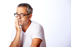 Concerned Middle Aged Man with Grey Hair