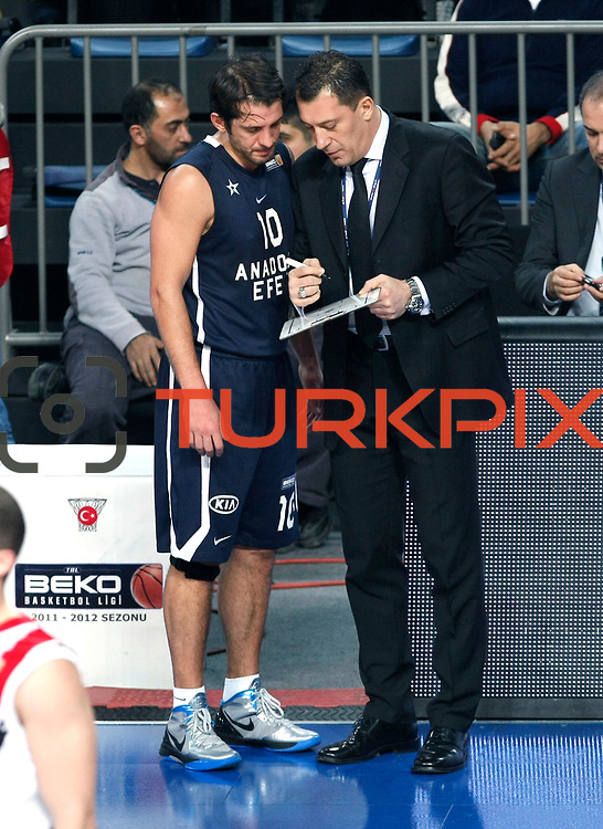 Anadolu Efes's coach Ufuk Sarica (R) during their Turkish Basketball League match Anadolu Efes between Bandirma Kirmizi at Sinan Erdem Arena in Istanbul, Turkey, Saturday, December 24, 2011. Photo by TURKPIX