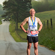 Jason Bailey ran the 2019 Boston Marathon with a time of 3:03:49. He trains for races while running loops that include country roads around his families cattle farm in Strawberry Plains, Tennessee. Nathan Lambrecht/Journal Communications