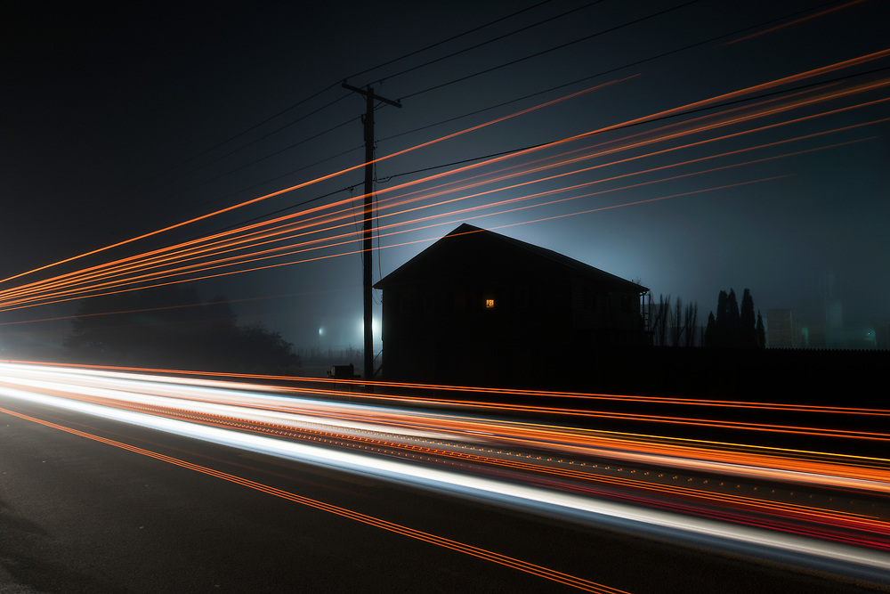 Truck lights frame a house in this long exposure taken in the town of Dailey along the Seneca Trail.