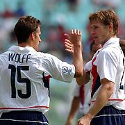 USA's Brian McBride celebrates scoring USA's first goal with Josh Wolff