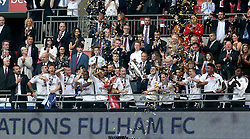 Fulham players celebrate promotion after the final whistle during the Sky Bet Championship Final at Wembley Stadium