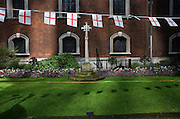 St George's Day flags fly during the lunchtime of 23rd April, England's national day. Christian worship has probably been offered at the church of St. Botolph's without Bishopsgate since Roman times. The original Saxon church, the foundations of which were discovered when the present church was erected, is first mentioned as 'Sancti Botolfi Extra Bishopesgate' in 1212.St. Botolph without Bishopsgate may have survived the Great Fire of London unscathed, and only lost one window in the Second World War, but on 24 April 1993 was one of the many buildings to be damaged by an IRA bomb. The memorial cross (1916) at the garden's entrance is believed to be the first memorial of the Great War to be set up in England.