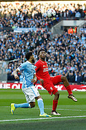 Daniel Sturridge of Liverpool (r) keeps his eye on the ball. Capital One Cup Final, Liverpool v Manchester City at Wembley stadium in London, England on Sunday 28th Feb 2016. pic by Chris Stading, Andrew Orchard sports photography.
