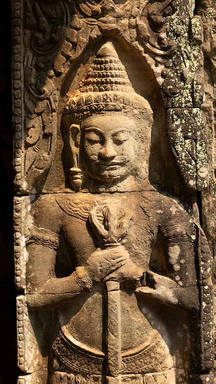 Ancient stone relief of a warrior in Angkor Wat, Cambodia