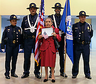 Juana Gonzalez, 93, of Peru poses for a picture in front of the US Customs & Border Protection Honor Guard after 3,003 new US citizens were sworn in today at the Miami Beach Convention Center. ..Left to right are officers Veronica Estrada, Angel Marquez, Peter Lashley, and Ernesto Vazquez.