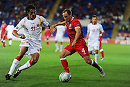 David Vaughan of   Wales (r) is challenged by Stefan Savic. Euro 2012 Qualifying match, Wales v Montenegro at the Cardiff City Stadium in Cardiff  on Friday 2nd Sept 2011. Pic By  Andrew Orchard, Andrew Orchard sports photography,