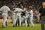 BOSTON - OCTOBER 7:  The Chicago White Sox celebrate after winning Game 3 of the American League Divisional Series against the Boston Red Sox at Fenway Park on October 7, 2005 in Boston, Massachusetts.   The White Sox defeated the Red Sox 5-3 to sweep the Red Sox and advance to the American League Championship Series.