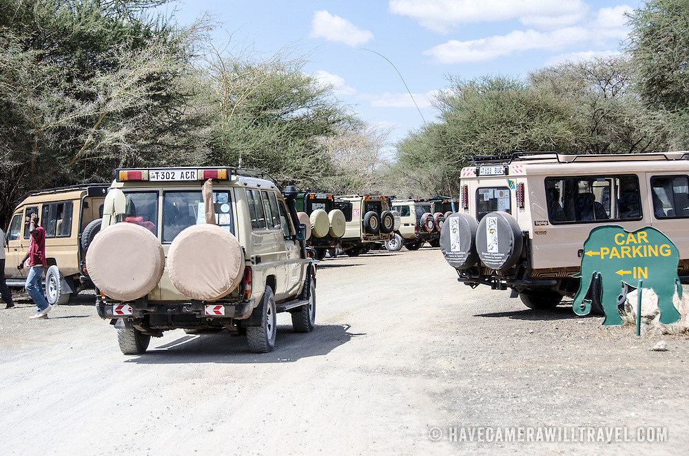 Safari vehicles lined up in the parking lot at the main entrance to Tarangire National Park in northern Tanzania not far from Ngorongoro Crater and the Serengeti.