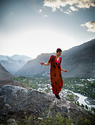 Woman wearing a local red dress. In Khorog town, capital of the Pamir and home of the Ismaili community.<br /> <br /> Tajikistan and the Tajik Pamir mountains (province of Gorno Badakhshan), summer 2009.