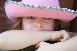 Little girl wearing a hat,