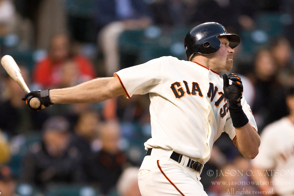 April 27, 2010; San Francisco, CA, USA;  San Francisco Giants right fielder Nate Schierholtz (12) hits a double against the Philadelphia Phillies during the second inning at AT&T Park.  San Francisco defeated Philadelphia 6-2.