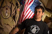Steven Acheson, an Iraq War veteran, at his apartment in Platteville, Wis. (Photo © Andy Manis)