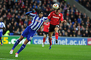 Sheff's Miguel Llera blocks as Cardiff city's Craig Bellamy sees his header go wide of goal. NPower championship, Cardiff city v Sheffield Wednesday at the Cardiff city Stadium in Cardiff on Sunday 2nd Dec 2012. pic by Andrew Orchard, Andrew Orchard sports photography,