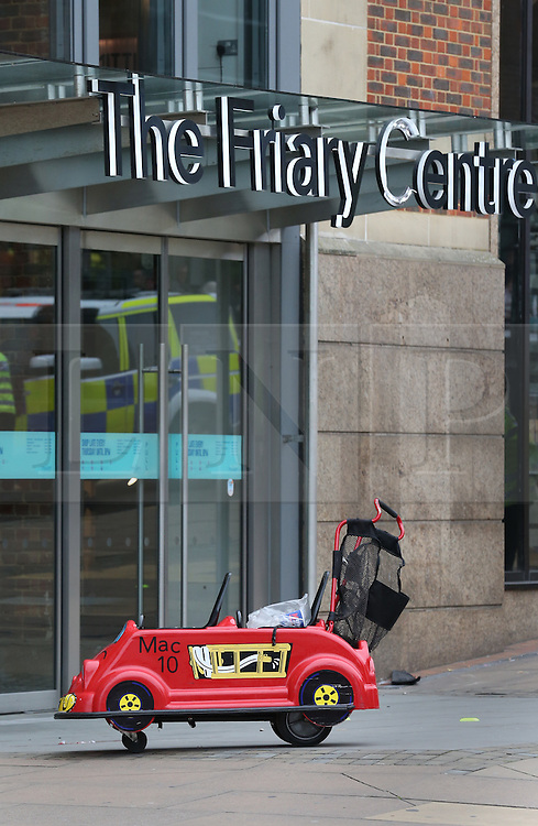 © Licensed to London News Pictures. 23/10/2015. Guilford, UK. . A child's shopping buggy is visible by the entrance to The Friary shopping centre after a car injured a number of pedestrians.  Photo credit: Peter Macdiarmid/LNP