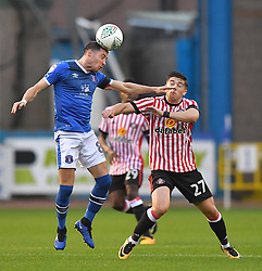 Carlisle United's Mike Jones battles with Sunderland's Lynden Gooch