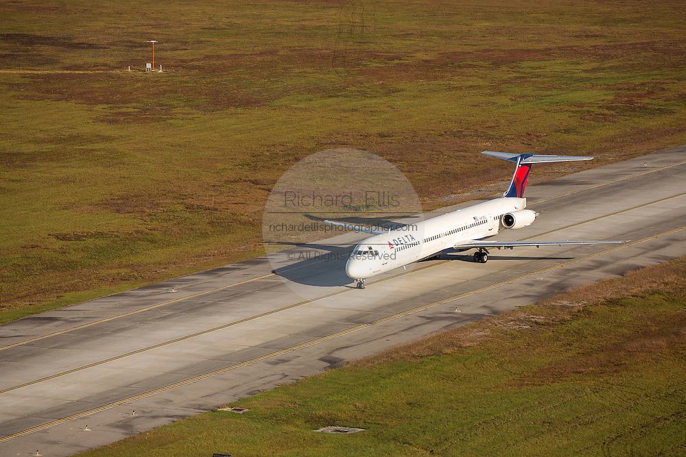 Aerial view of Delta Airlines MD-88 aircraft taxing at Charleston International Airport Charleston, South Carolina.