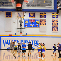 010715       Cable Hoover<br /> <br /> Contestants try their luck in the half-court shooting contest during half-time of the varsity basketball game at Sanders Valley High School Wednesday. Freshman Laramie Semallie, center, won the contest by successfully making the shot twice.