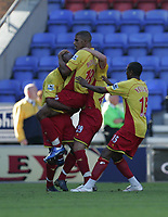 Photo: Andi Thompson.<br />Wigan Athletic v Watford. The Barclays Premiership. 23/09/2006.<br />Watford's Hamer Bouazza (lifted) celebrates his goal for Watford