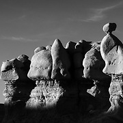 The last light of the day create more shapes in the shadows upon the hoodoos in Goblin Valley State Park, Utah.