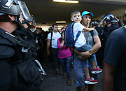 Migrants are escorted from the train on to a bus at Bicske train station in Hungary as a tense stand-off between police and migrants continued into a second day.