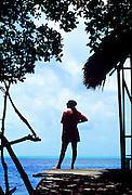 Woman enjoying view of tropical ocean water, Ambergris Caye, Belize
