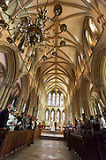 Wide angle shot of the Bride and Groom at the Altar of Southwell Minster