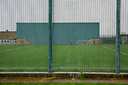 The Multi Use games Area (MUGA) behind security fencing inside HMP Downview, Surrey, United Kingdom. HMP Downview is a women's closed category prison for adult sentenced women and convicted and remand female young people located on the outskirts of Banstead in Surrey, England. (Picture credit: © Andy Aitchison)