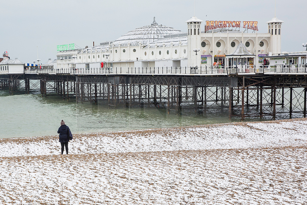 """© Licensed to London News Pictures. 18/03/2018. Brighton, UK. Brighton's Palace Pier and Brighton and Hove beach are covered in a layer of snow as a second """"Beast from the East"""" is hitting the South Coast. Photo credit: Hugo Michiels/LNP"""