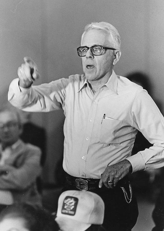 ©1990  man speaking up at neighborhood meeting.