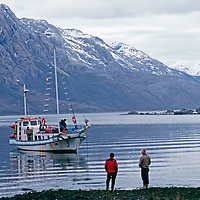 A boat retrieves an expedition in a previously unexplored Chilean range.