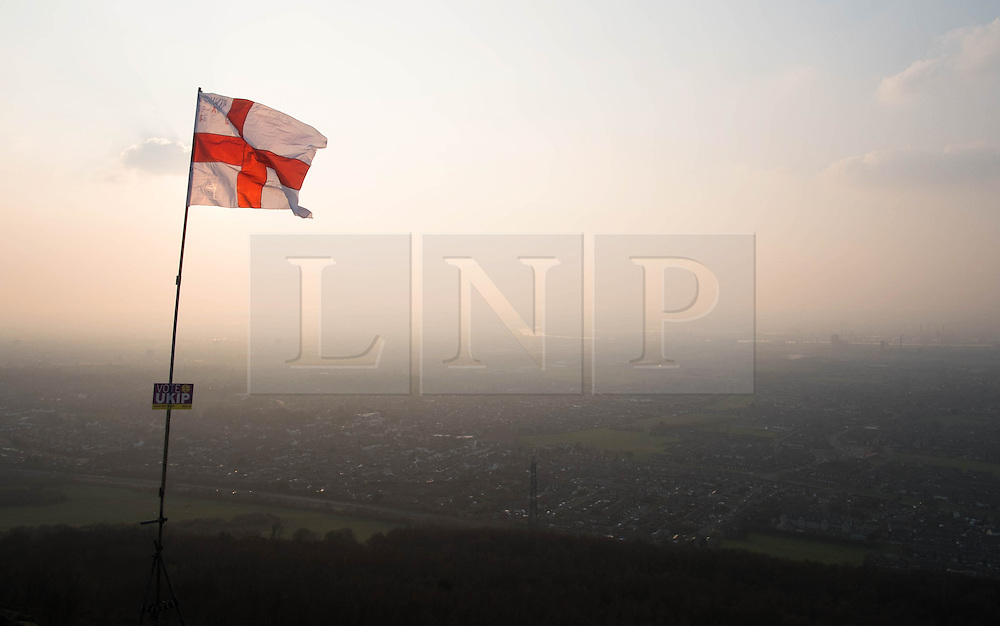 © Licensed to London News Pictures. <br /> 10/04/2015. <br /> Eston, United Kingdom<br /> <br /> A St George flag with a placard showing support for UKIP flies at the top of local landmark, Eston Nab on Teesside ahead of the General Election on May 7.<br /> <br /> Photo credit : Ian Forsyth/LNP