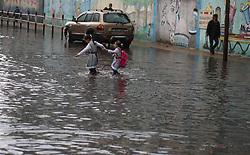 November 10, 2018 - Gaza, gaza strip, Palestine - Palestinian school children walk in a flooded street during heavy rain in Gaza City on November 10, 2018. (Credit Image: © Majdi Fathi/NurPhoto via ZUMA Press)