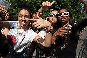 The 49th Notting Hill Carnival in West London. A celebration of West Indian / Caribbean culture and Europe's largest street party, festival and parade. Revellers come in their hundreds of thousands to have fun, dance, drink and let go in the brilliant atmosphere. Group of girls arrive in high spirits.