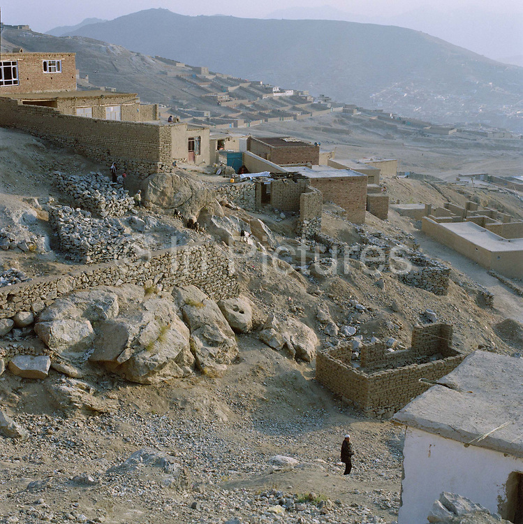 Housing development on side of a mountain in North Kabul, there are no sewage facilities, running water or mains electricity, but building a house here gives Afghans an opportunity to own their own home.