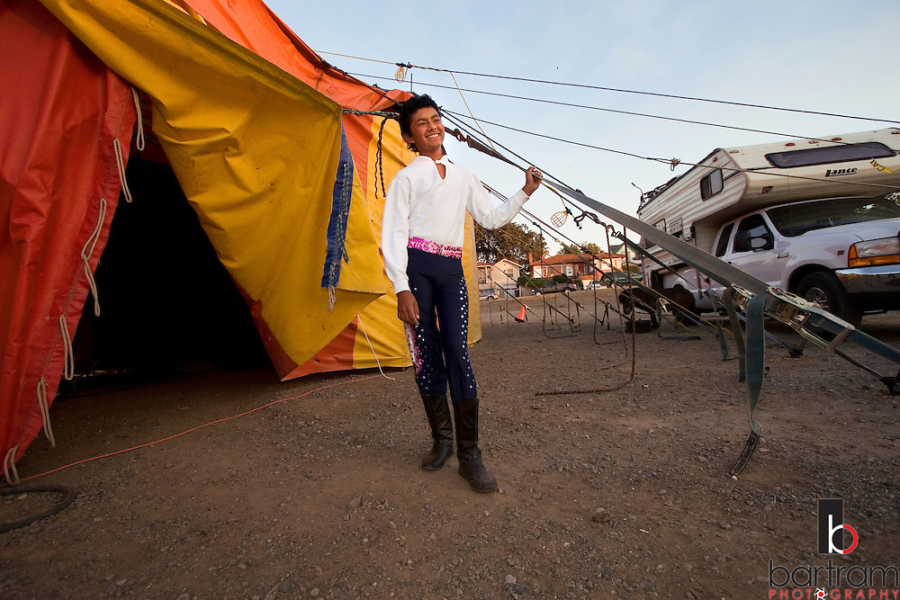 Angel Perez, 14, waits outside the big top between performances of the American Crown Circus/Circo Osorio in downtown Antioch, California.