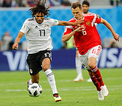 June 19, 2018 - Saint Petersburg, Russia - Denis Cheryshev (R) of Russia national team and Mohamed Elneny of Egypt national team vie for the ball during the 2018 FIFA World Cup Russia group A match between Russia and Egypt on June 19, 2018 at Saint Petersburg Stadium in Saint Petersburg, Russia. (Credit Image: © Mike Kireev/NurPhoto via ZUMA Press)