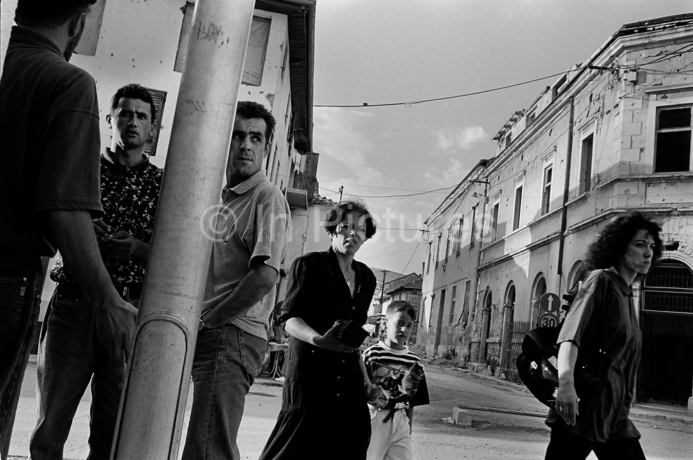 """Street life returns to normal after the end of the Muslim Croat war. It was destroyed by systemic bombardment from Croat guns during the Croat Muslim War, when the Croats endeavored to """" cleanse"""" the town of non Croats. Mostar, Bosnia and Herzegovina."""
