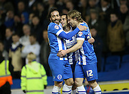 Sam Baldock, Brighton striker scores a goal and celebrates with Craig Mackail-Smith, Brighton striker and Inigo Calderon, Brighton defender during the Sky Bet Championship match between Brighton and Hove Albion and Leeds United at the American Express Community Stadium, Brighton and Hove, England on 24 February 2015.