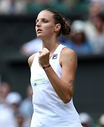 Karolina Pliskova celebrates winning the first set against Victoria Azarenka on day three of the Wimbledon Championships at the All England Lawn Tennis and Croquet Club, Wimbledon.