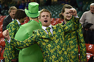 An Ireland fan shows his delight as he celebrates the Ireland win at end of match. Rugby World Cup 2015 pool D match, France v Ireland at the Millennium Stadium in Cardiff, South Wales  on Sunday 11th October 2015.<br /> pic by  Andrew Orchard, Andrew Orchard sports photography.