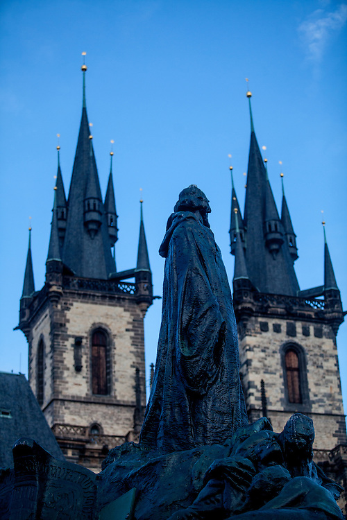 """The monument of Jan Hus at the Prague Old Town Square was designed by Ladislav Saloun. The foundation stone was laid down in 1903 and the monument was unofficially revealed on 6 th July 1915, the 500th anniversary of Jan Hus´s death. The  inscription reads: """"Love each other and wish the truth to everyone"""" (Jan Hus´s words), """"Live, nation sacred in God, don´t die"""", """"I believe, that the anger thunders will cease and that the government of your affairs will return to your hands, Czech folk"""" and """"Who are the warriors of God and his law"""" (words from the anthem of the Hussite warriors)."""