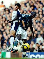 Photo: Daniel Hambury.<br />Tottenham Hotspur v Newcastle United. The Barclays Premiership. 31/12/2005.<br />Tottenham's Lee Young-Pyo (L) and Newcastle's Amdy Faye battle for the ball.