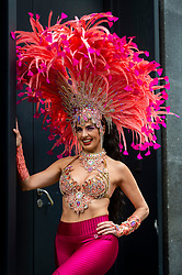 © Licensed to London News Pictures. 29/08/2021. LONDON, UK.  A samba dancer in colourful costume takes part in a flashmob around the West End organised by fashion brand RioPump GymWear.  The August Bank Holiday weekend would normally see tens of thousands of people watching events at the Notting Hill Carnival, including samba dancers, but for the second year running, the carnival has been cancelled due to Covid-19 concerns.  Photo credit: Stephen Chung/LNP