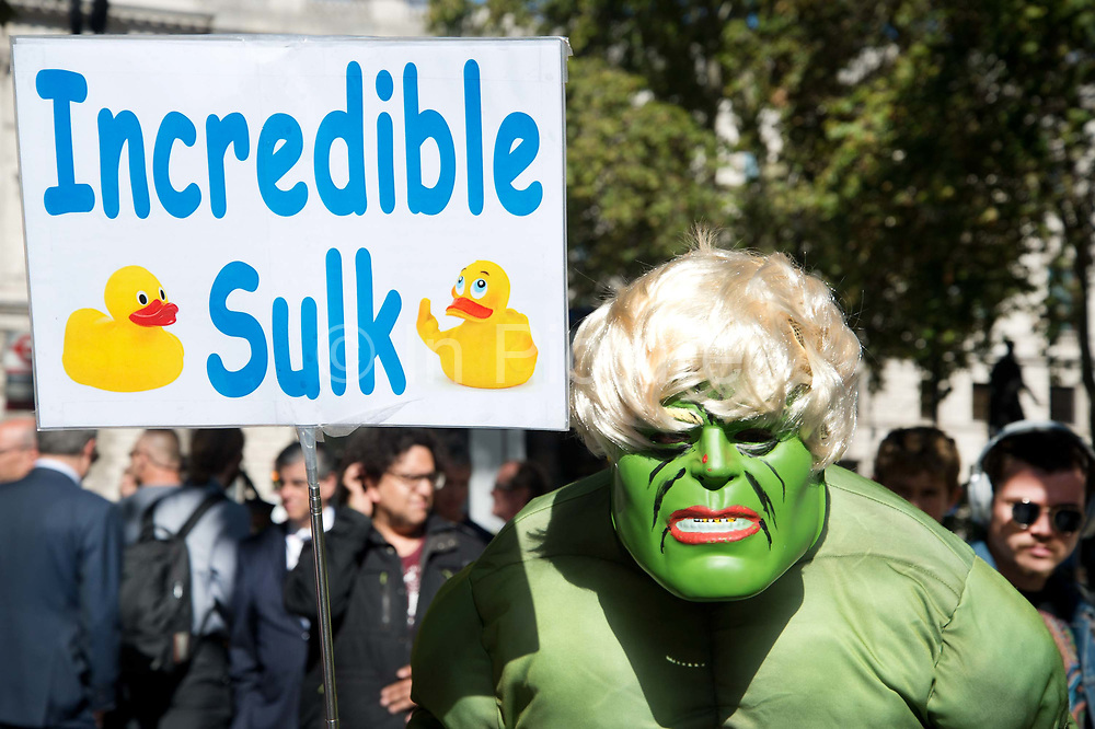 Protester dressed up as the Incredible Hulk with his Incredible Sulk placard in reference to Boris Johnsons recent comment The madder Hulk gets, the stronger Hulk gets. outside The Supreme Court as the first day of the hearing to rule on the legality of suspending or proroguing Parliament begins on September 17th 2019 in London, United Kingdom. The ruling will be made by 11 judges in the coming days to determine if the action of Prime Minister Boris Johnson to suspend parliament and his advice to do so given to the Queen was unlawful.