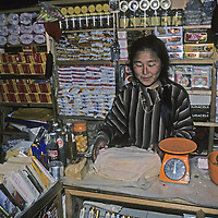 NEPAL, HIMALAYA.  Pasang, a Sherpa girl in her parents' trekking store at Khumbu Lodge in Namche Bazaar, Khumbu Region.  She became 1st Sherpa dentist (picture from 1986).