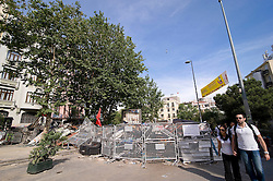 © London News Pictures. 06/06/2013 . Istanbul, Turkey.  Barriers erected in in Taksim Square in Istanbul following clashes with police using teargas and water canons early in the morning. Many protestors put up tents and stay overnight. Violence broke out when police attacked a protest against the demolition of Gezi Park and the construction of another shopping mall in its place at Taksim Square.  Photo credit Claudia Wiens/LNP