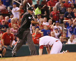 September 26, 2017 - St Louis, MO, USA - Third base umpire Jim Reynolds calls out the St. Louis Cardinals' Jedd Gyorko, who was trying to take two bases on a single by Paul DeJong in the third inning against the Chicago Cubs on Tuesday, Sept. 26, 2017, at Busch Stadium in St. Louis. The Cards won, 8-7. (Credit Image: © Chris Lee/TNS via ZUMA Wire)