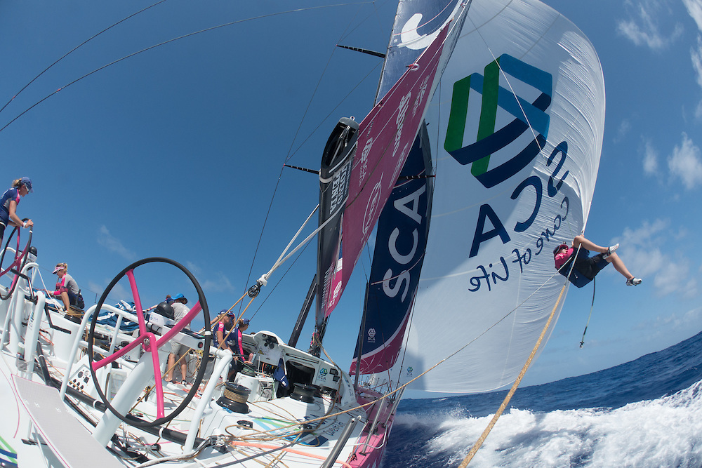 May 3, 2015. Leg 6 to Newport onboard Team SCA. Day 15. Stacey Jackson puts a second sheet on the A3.